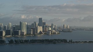 AX0029_009E - 5K stock footage aerial video of flying by Downtown Miami skyline, Florida, sunrise