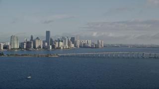AX0029_011 - 5K stock footage aerial video of downtown skyline, Rickenbacker Causeway bridge, Miami, Florida, sunrise