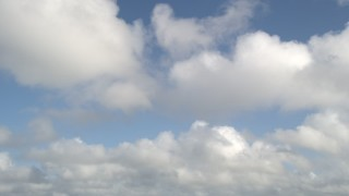 AX0030_059 - 5K stock footage aerial video of following clouds overhead, Florida Everglades, Florida