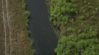 AX0030_102 - 5K stock footage aerial video of following a river, Florida Everglades, Florida