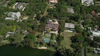 AX0031_005 - 5K stock footage aerial video of approaching mansion, tilt down, Coral Gables, Florida