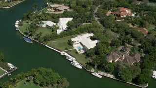 AX0031_006 - 5K stock footage aerial video fly over canals, tilt down to mansion on shore, Coral Gables, Florida