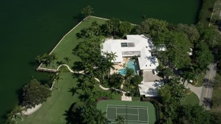 AX0031_007 - 5K stock footage aerial video of flying over a mansion by the water, Coral Gables, Florida
