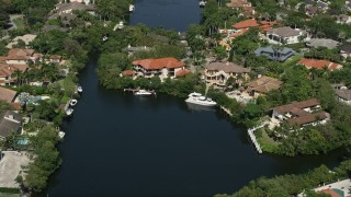 AX0031_008 - 5K stock footage aerial video of flying by mansions near canal, Coral Gables, Florida