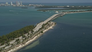 AX0031_019 - 5K stock footage aerial video of flying by bridge on Rickenbacker Causeway, Biscayne Bay, Florida