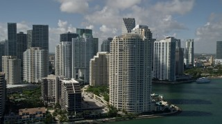 AX0031_025E - 5K stock footage aerial video of flying by Brickell Key, Downtown Miami skyscrapers, Miami, Florida