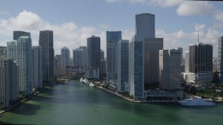 AX0031_026 - 5K stock footage aerial video of flying by skyscrapers on Brickell Key, reveal Miami River, Downtown Miami, Florida