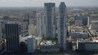 AX0031_027 - 5K stock footage aerial video of approaching North and South Tower of Vizcayne, tilt down on pool, Downtown Miami, Florida