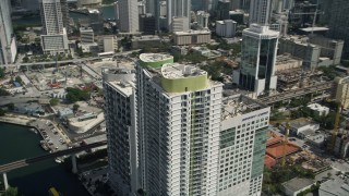 AX0031_031 - 5K stock footage aerial video of Latitude on the River skyscraper, Downtown Miami, Florida