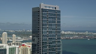AX0031_033 - 5K stock footage aerial video of the top of Four Seasons Hotel Miami, Downtown Miami, Florida
