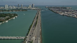 AX0031_043 - 5K stock footage aerial video of flying over MacArthur Causeway, revealing South Beach, Miami Beach, Florida