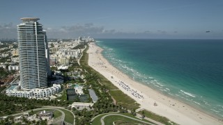 AX0031_050 - 5K stock footage aerial video of flying by the beach along the coast, South Beach, Miami Beach, Florida