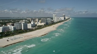 AX0031_057 - 5K stock footage aerial video of following the coast and beach lined with hotels, Miami Beach, Florida