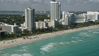 AX0031_058 - 5K stock footage aerial video of flying by the beach near Fontainebleau Miami Beach, Miami Beach, Florida