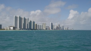 AX0031_074 - 5K stock footage aerial video of flying by Trump Towers, Sunny Isles Beach, Florida