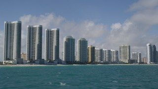AX0031_075 - 5K stock footage aerial video fly by Trump Towers, condominium complexes, Sunny Isles Beach, Florida