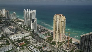 AX0031_083 - 5K stock footage aerial video of Acqualina Resort and Spa, Trump International Beach Resort, Sunny Isles Beach, Florida