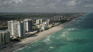 AX0031_092 - 5K stock footage aerial video of following beach near Hollywood Beach Condominiums, Hollywood, Florida