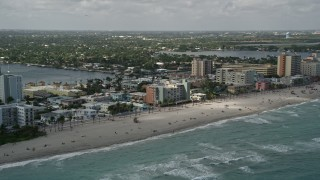 AX0031_093 - 5K stock footage aerial video of flying by the beach, Hollywood, Florida