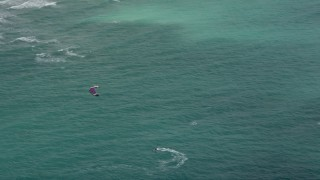 AX0031_097 - 5K stock footage aerial video track a kite surfer near the coast, Hollywood, Florida