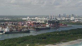 AX0031_099 - 5K stock footage aerial video of flying by cargo ships at Port Everglades; Fort Lauderdale, Florida