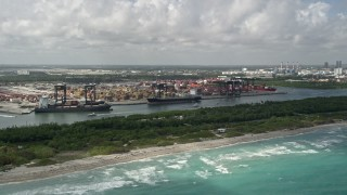 AX0031_100 - 5K stock footage aerial video of cargo ships, Port Everglades, Fort Lauderdale, Florida