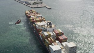 AX0031_104 - 5K stock footage aerial video flyby a cargo ship at Port Everglades, Fort Lauderdale, Florida