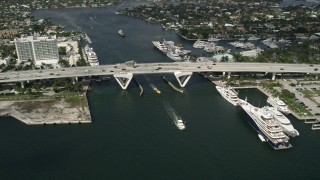 AX0031_109 - 5K stock footage aerial video of approaching Southeast 17th Street bridge, yachts, Fort Lauderdale, Florida