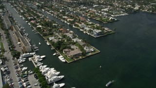 AX0031_110 - 5K stock footage aerial video of flying by mansions on the river, Fort Lauderdale, Florida