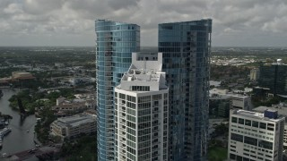 AX0031_116 - 5K stock footage aerial video of flying by the top of Las Olas River House, Downtown Fort Lauderdale, Florida