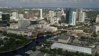 AX0031_118E - 5K stock footage aerial video of flying over the New River and Downtown Fort Lauderdale, Florida