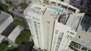 AX0031_121 - 5K stock footage aerial video of approaching condominium complex, tilt to bird's eye view, Fort Lauderdale, Florida