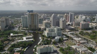 AX0031_124 - 5K stock footage aerial video of flying over New River by Downtown Fort Lauderdale, Florida