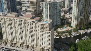 AX0031_125 - 5K stock footage aerial video of orbiting top of a condominium complex, Downtown Fort Lauderdale, Florida