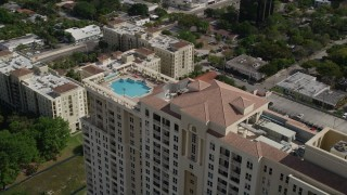 AX0031_126 - 5K stock footage aerial video of flying by top of condominium complex with a pool, Fort Lauderdale, Florida