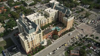AX0031_130 - 5K stock footage aerial video of approaching condominium complex, tilt down, Downtown Fort Lauderdale, Florida