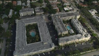 AX0031_132 - 5K stock footage aerial video of flying by apartment buildings, tilt down, Fort Lauderdale, Florida
