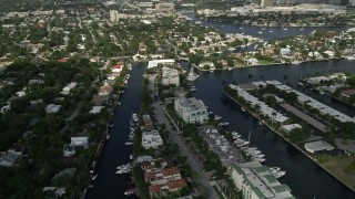 AX0031_133 - 5K stock footage aerial video of flying by residential neighborhoods and canals, Fort Lauderdale, Florida