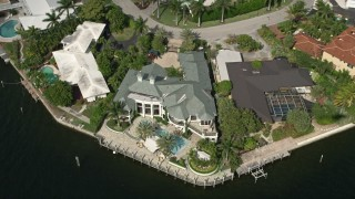 AX0031_135 - 5K stock footage aerial video of waterfront mansions beside a canal, Fort Lauderdale, Florida