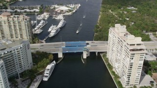 AX0031_137 - 5K stock footage aerial video follow canal, approaching East Sunset Boulevard bridge, Fort Lauderdale, Florida