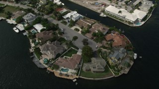AX0031_139 - 5K stock footage aerial video of approaching mansions by canals, tilt down, Fort Lauderdale, Florida