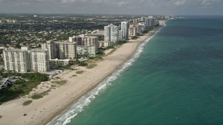 AX0031_148 - 5K stock footage aerial video of following the beach, Lauderdale by the Sea, Florida
