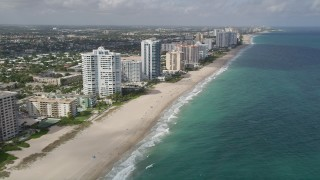AX0031_149 - 5K stock footage aerial video of following the beach past apartment complexes, Lauderdale by the Sea, Florida