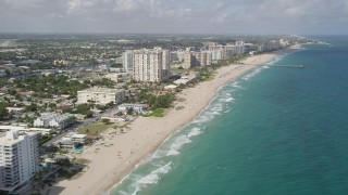 AX0031_152 - 5K stock footage aerial video fly by beach, hotels, approach Pompano Beach Pier, Pompano Beach, Florida