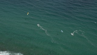 AX0031_158 - 5K stock footage aerial video of flying by kite surfers off the coast, Hillsboro Beach, Florida