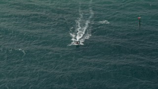 AX0031_160 - 5K stock footage aerial video of tracking a speedboat, Hillsboro Beach, Florida