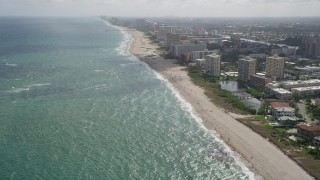 AX0031_162 - 5K stock footage aerial video of flying by kite surfers, Pompano Beach, Florida