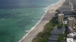 AX0031_163 - 5K stock footage aerial video of flying by kite surfers, Pompano Beach, Florida