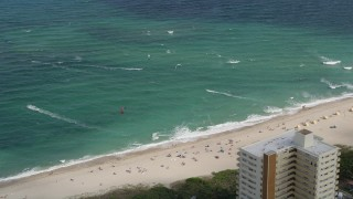 AX0031_164 - 5K stock footage aerial video of flying by kite surfers, Pompano Beach, Florida