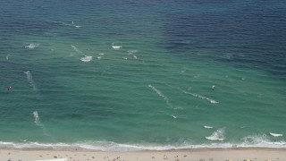 AX0031_165 - 5K stock footage aerial video of flying by kite surfers, Pompano Beach, Florida